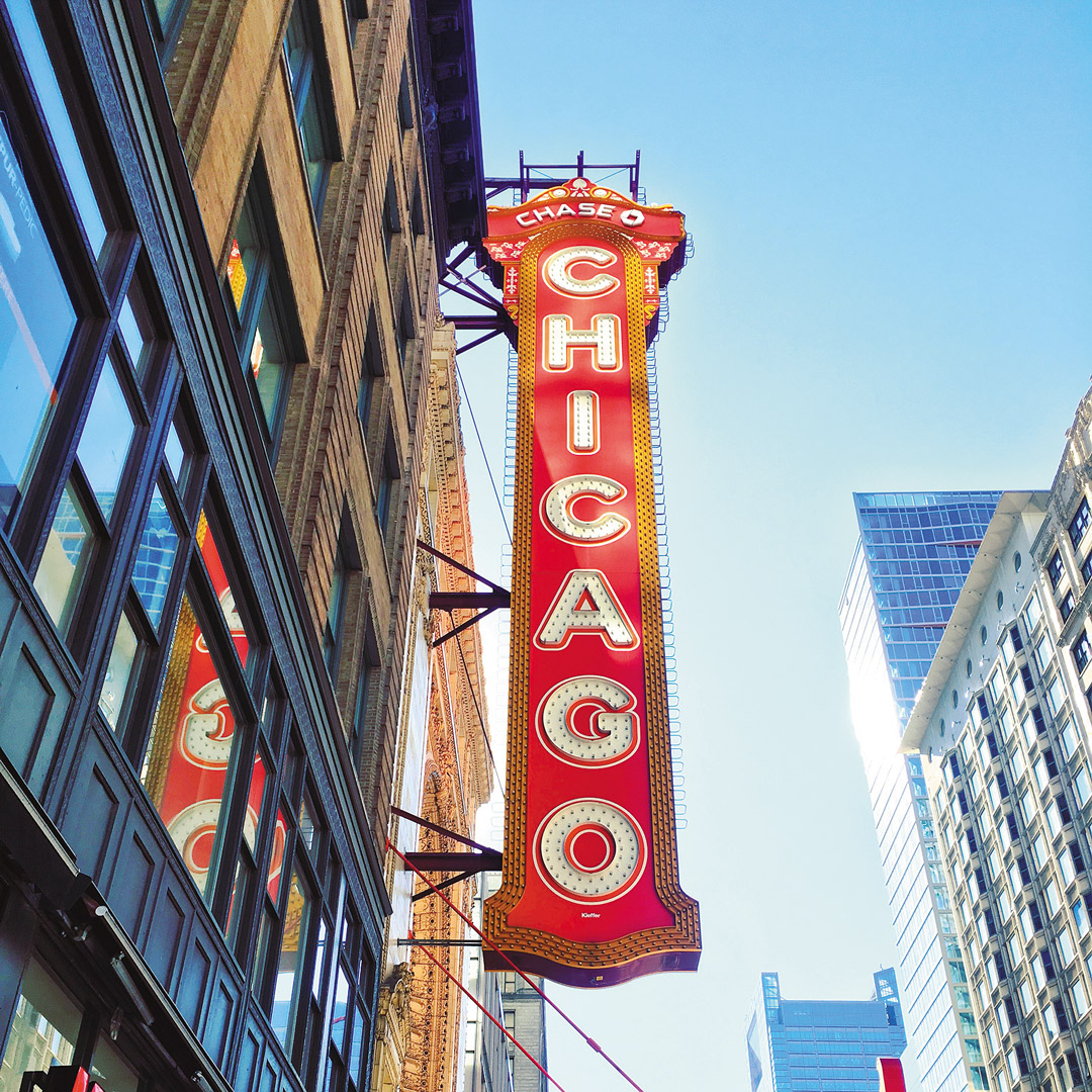 red marquis sign over the Chicago Theater