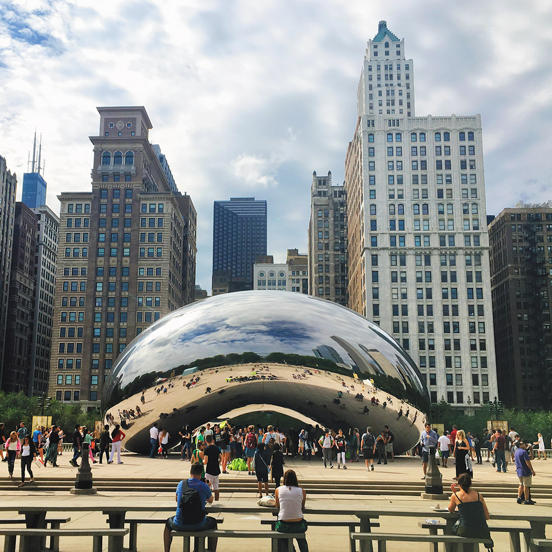 public art shaped like a bean in front of skyscrapers in Chicago's Loop