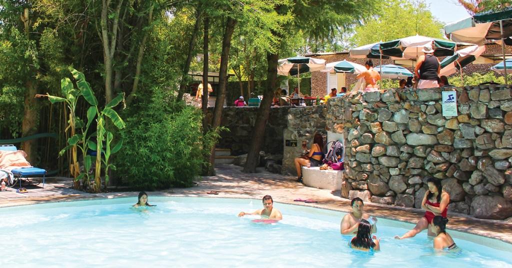 people soaking in hot springs