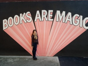 "Image of Sarah Falter in front of ""BOOKS ARE MAGIC"" display"